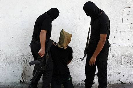 Hamas gunmen prepare to execute Palestinian alleged collaborator with Israel, August 22, 2014.