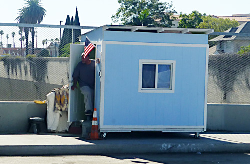 One of Elvis Summers' tiny houses, taken from a homeless man on the 42nd Street bridge over the Harbor Freeway.