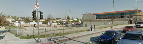 Contested lot at Lorena and East 1st Street in Boyle Heights, proposed site of a 49 unit apartment house, half for mentally ill homeless people. El Mercado shopping center (at the right of the photo) has led the opposition to the project and been supported by Jose Huizar, chair of the Los Angeles City Council Planning and Land Use Management Committee.