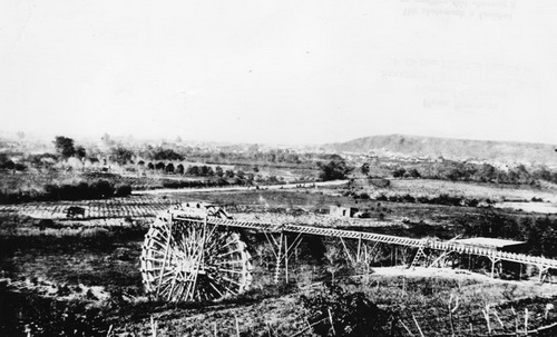 Water wheel at entrance of what is now Solano Canyon, circa 1860.
